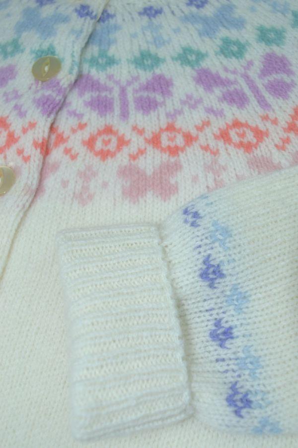 Girls fair isle cardigan. Butterfly rainbow. White close up
