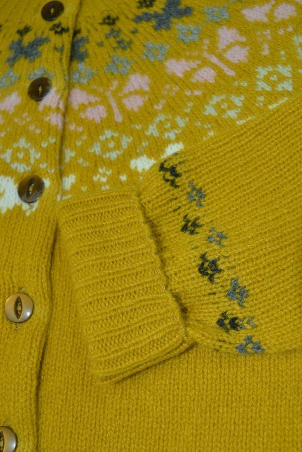Girls fair isle cardigan. Butterfly rainbow. Yellow close up